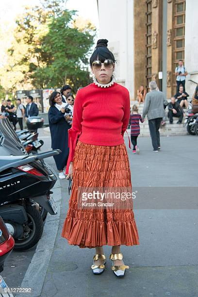 Fashion journalist Susie Lau wears a ShuShu Tong top Molly Goddard skirt Meadham Kirchhoff shoes and Chloe sunglasses on day 2 of Paris Womens...