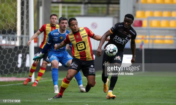 Fashion Junior Sakala of KV Oostende battles for the ball with Lucas Bijker of KV Mechelen during the Jupiler Pro League Europe play-offs match day 2...