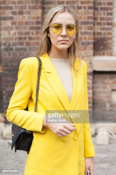Fashion Lawyer Violet Atkinson is wearing a Topshop suit Isabelle Quinn glasses and Chanel bag during MercedesBenz Fashion Week Resort 18 Collections...