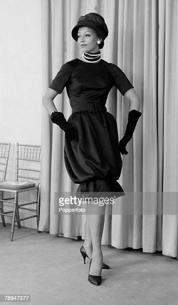 Fashion London 2nd September 1959 A model wears an outfit from the Christian Dior 'Winter Collection' an amber print satin 'Sheath' dress