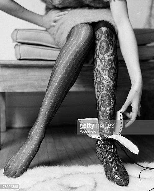 Fashion London England A model wearing a comtempary lace stocking contrasts with a black lace stocking and shoe from the era circa 1913