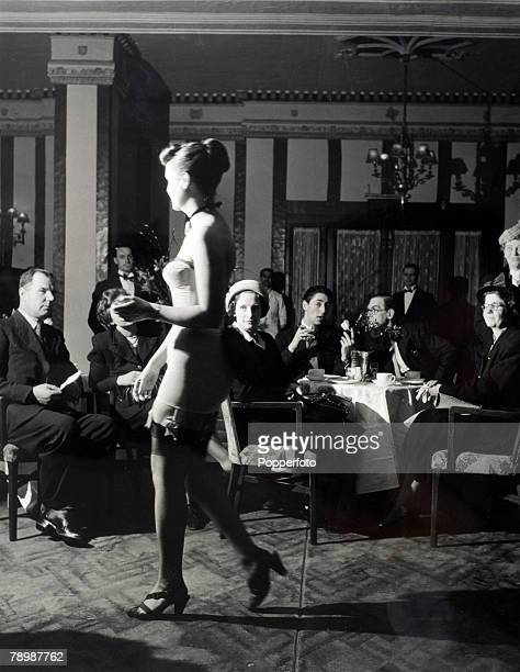 Fashion London England Buyers from major retail stores look at model wearing a strapless streamlined corset