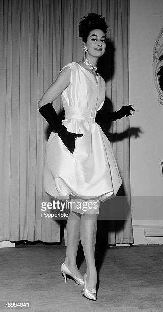 Fashion London England November 1959 A pure white silk cocktail dress with above the knee flounced skirt from the Christian Dior Spring collection