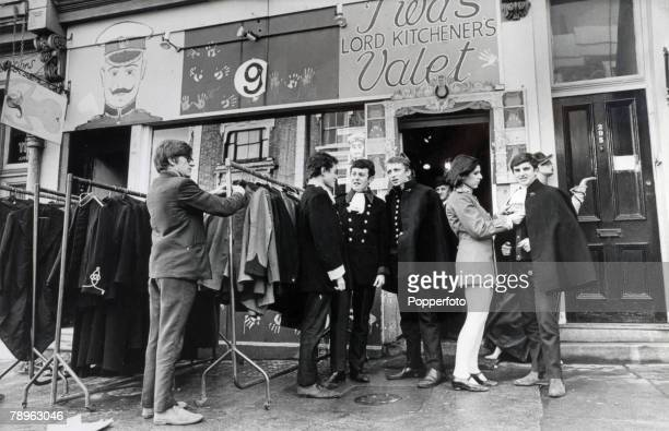 Fashion London England Shoppers examining the racks of clothes outside the boutique called 'I Was Lord Kitcheners Valet' on Portobello Road