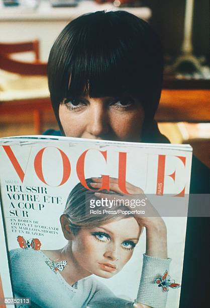 """Fashion London, Famous fashion designer Mary Quant reads a copy of """"Vogue"""" magazine, featuring Twiggy on the front cover, in her London boutique"""