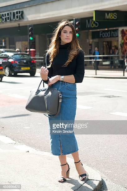 Fashion market editor and writer Francesca Donnelly is wearing a denim skirt and Givenchy bag on day 4 of London Collections Women on September 15...