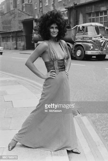 Fashion model Aldine Honey wearing a polka dotted long dress with plunging neckline and narrow waist London UK 9th September 1969
