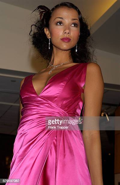 Fashion model Amie wears a Valentino Couture hot pink satin gown with Martin Katz marquis diamond drop necklace 45 cts and matching marquis drop...