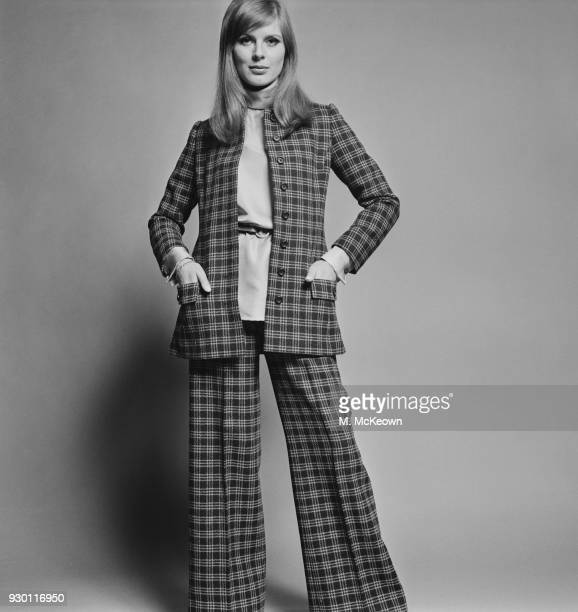 Fashion model and Vogue cover girl Paulene Stone wearing checked trousers suit UK 30th May 1968