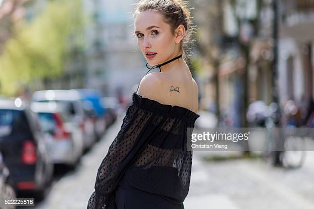 Fashion model Anna Wilken with a bun and angels wing tattoo wearing a black strapless sheer top from NaKd a black NaKd necklace on April 18 2016 in...