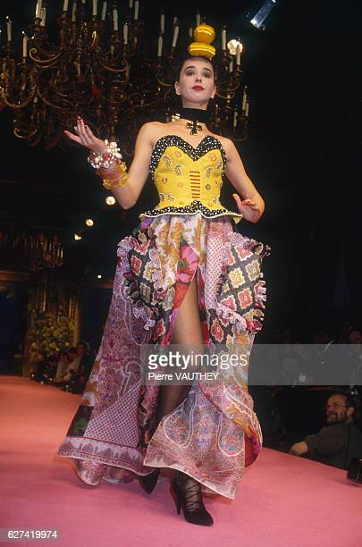 Fashion model Anne Rohart wears a haute couture evening gown with yellow bodice by French fashion designer Christian Lacroix She is modeling the...