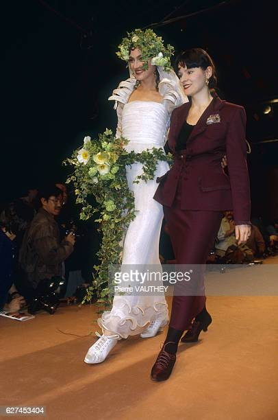 Fashion model Anne Rohart wears a readytowear wedding dress by French fashion designer Lolita Lempicka as they walk down the catwalk together Rohart...