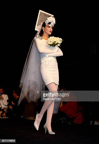 Fashion model Anne Rohart wears a white wedding dress with a veil by French fashion designer Sonia Rykiel at her springsummer 1988 fashion show in...