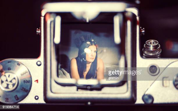 fashion model as seen through old middle format film camera - photographic film camera stock photos and pictures