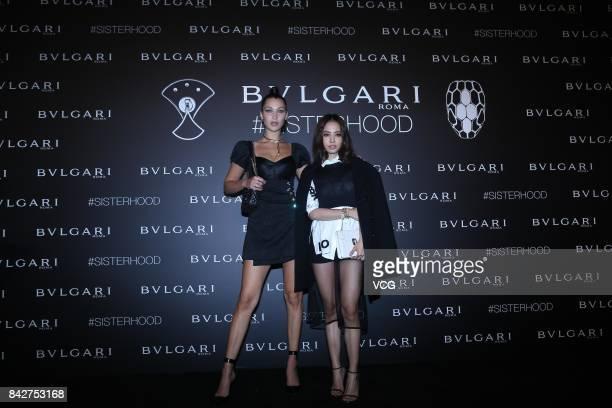 Fashion model Bella Hadid and singer Jolin Tsai pose at Bvlgari's sisterhood themed party on September 1 2017 in Beijing China