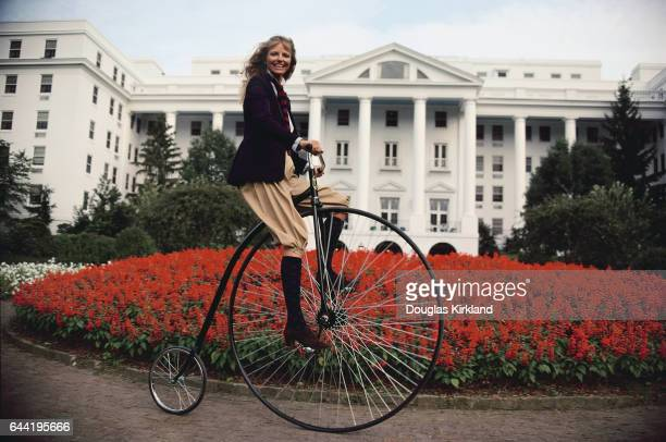Fashion model Cheryl Tiegs rides a velocipede in Greenbrier Resort's turnaround