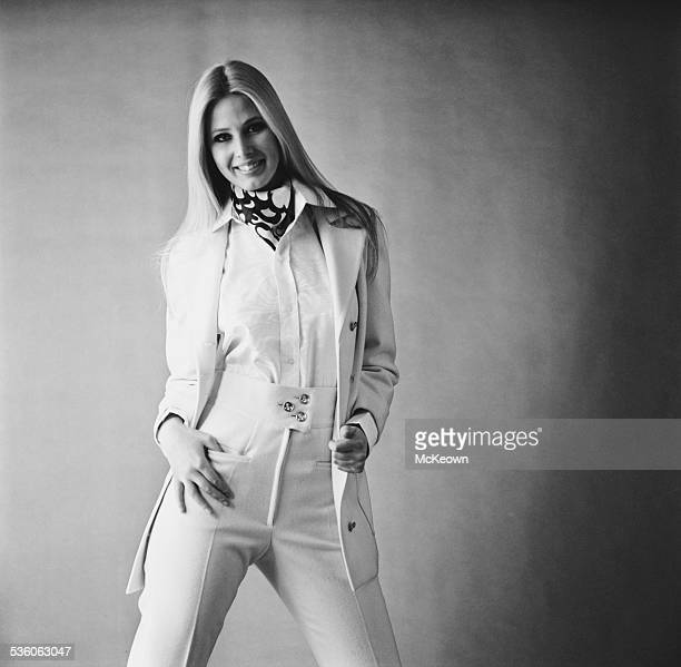 Fashion model Christine Eastley shows a high waist pant suit blouse and cravat 13th February 1967
