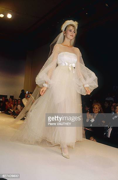 Fashion model Claudia Schiffer wears a haute couture wedding dress by German fashion designer Karl Lagerfeld for French fashion house Chanel She...