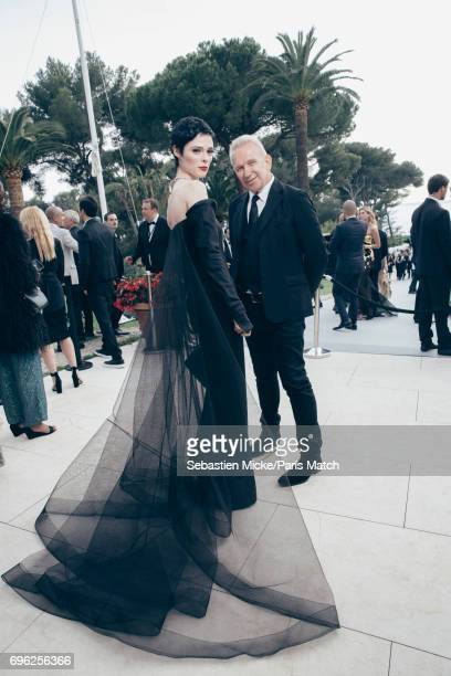Fashion model Coco Rocha and designer Jean Paul Gaultier are photographed for Paris Match whilst attending the Amfar Gala at the Eden Roc Hotel on...