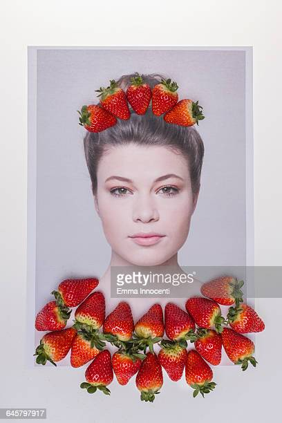 Fashion model covered by strawberries