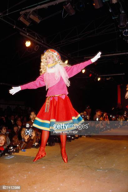 Fashion model dances in ready-to-wear women's fashions by Japanese designer Kenzo Takada for his fashion house Kenzo during a 1982-1983 Fall-Winter...