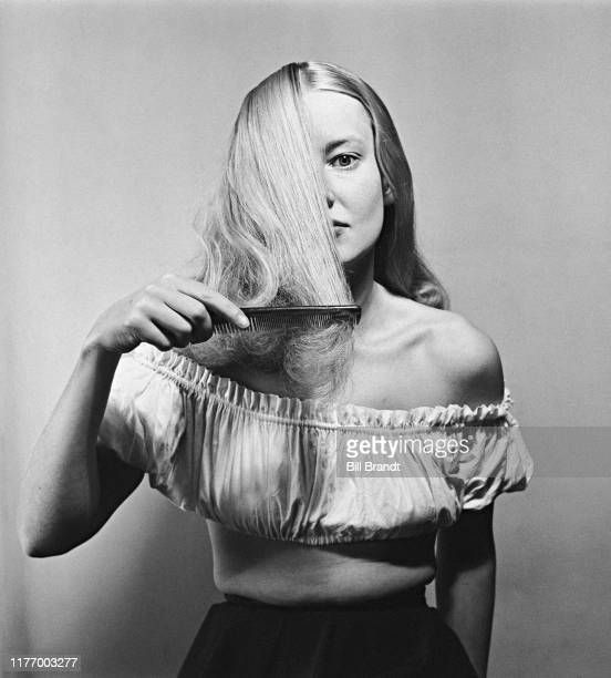 A fashion model demonstrates combing her hair London September 1949 Original Publication Picture Post 4887 Her hair is a fashion asset pub 24th...