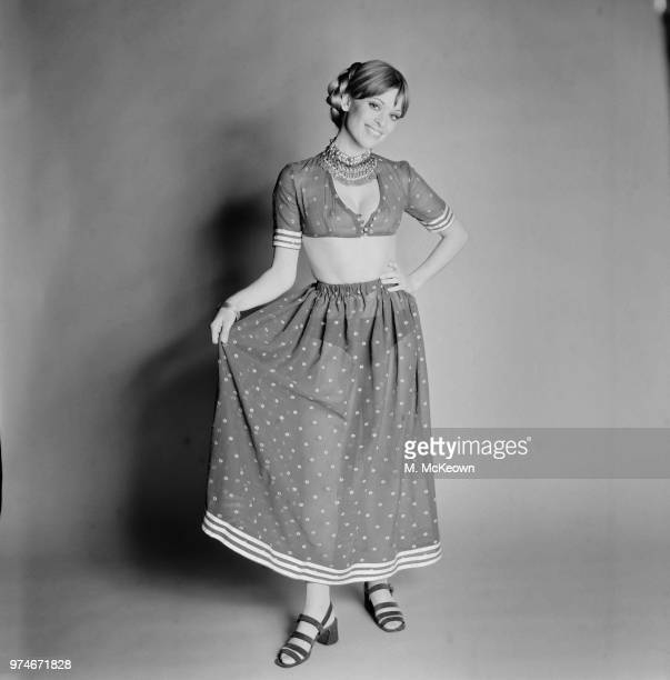 Fashion model Edina Ronay wearing dotted crop top and long skirt sandals and choker UK 29th March 1970