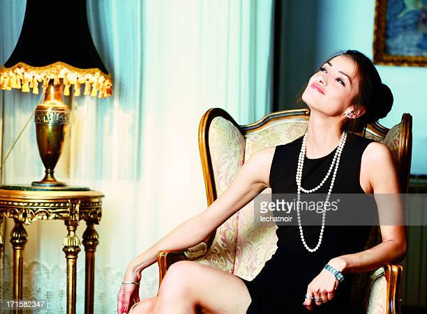 fashion model enjoys the riches - necklace stock pictures, royalty-free photos & images