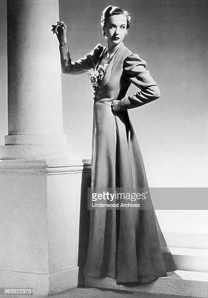 A fashion model from Robert Piguet fashion house wearing a summer evening frock with transparent taffeta overcoat Paris France July 8 1936