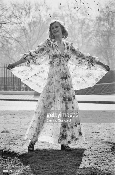 Fashion model Georgina Harding wearing a summer dress in a semi-transparent fabric, with a matching cape, UK, 3rd April 1973.
