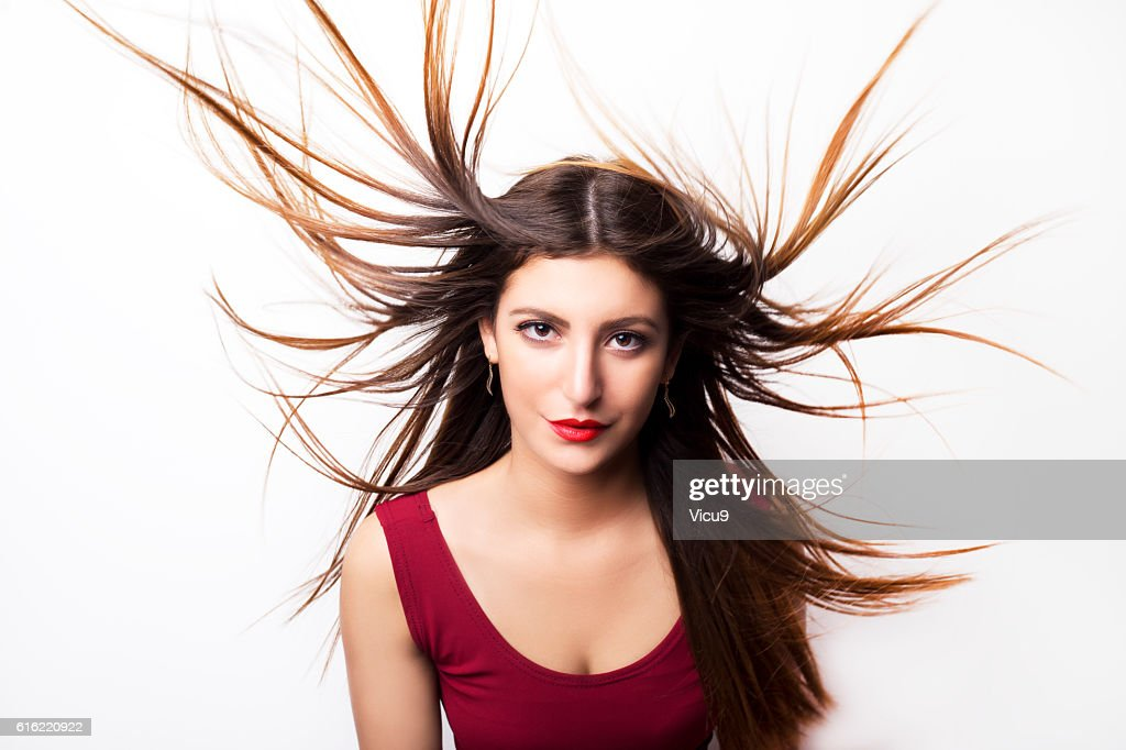 Fashion model girl portrait with long blowing hair. : Stock-Foto
