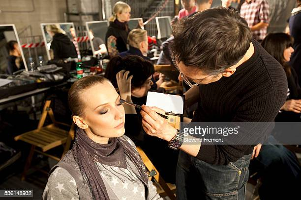 Fashion model having makeup done