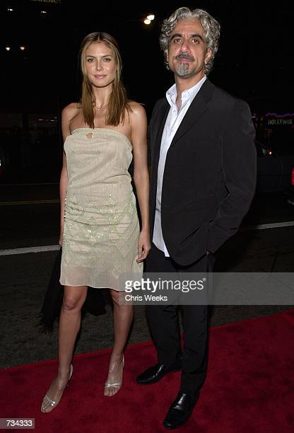 Fashion model Heidi Klum and husband Rick Pepino attend the premiere of The Sixth Day November 13 2000 in Westwood CA