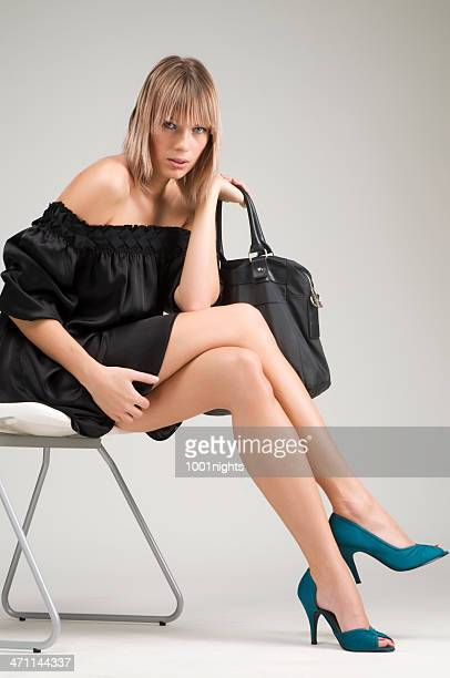 fashion model holding handbag