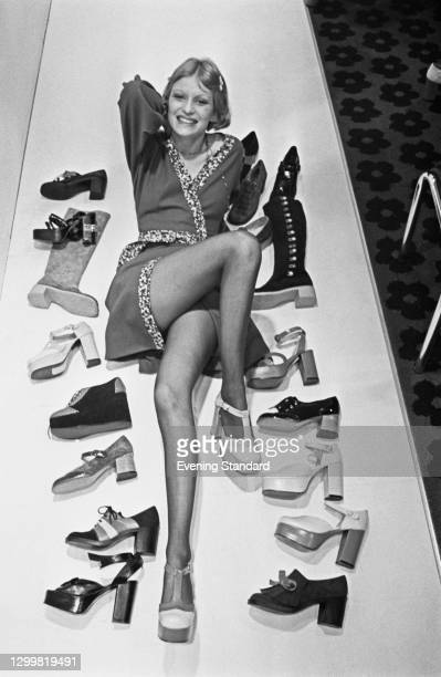 Fashion model Ika posing with with an array of Mary Quant footwear from the autumn and winter range, including several platform heels, UK, 14th April...