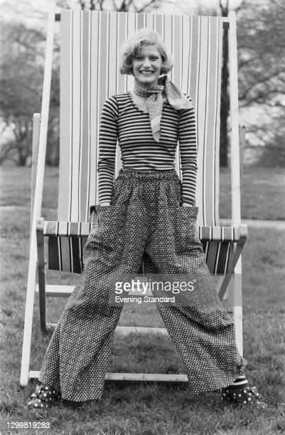 Fashion model Ika wearing baggy trousers and a striped jersey with a neckerchief, UK, 10th April 1972.
