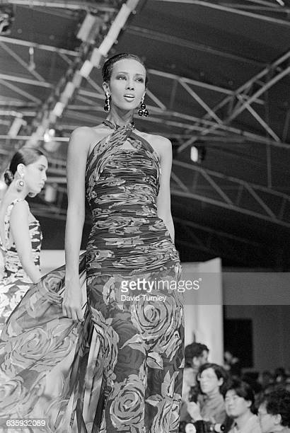 Fashion model Iman models an evening gown on the runway