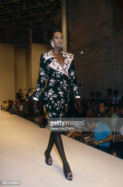 Fashion model Iman wearing a haute couture cocktail dress by French fashion designer Emanuel Ungaro She is modeling the dress during his AutumnWinter...