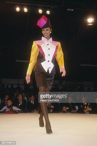 Fashion model Iman wears a multicolored readytowear suit by French fashion designer Yves Saint Laurent She is modeling the suit during his...