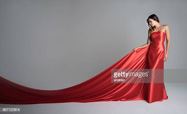 fashion model in a red long dress - robe longue photos et images de collection