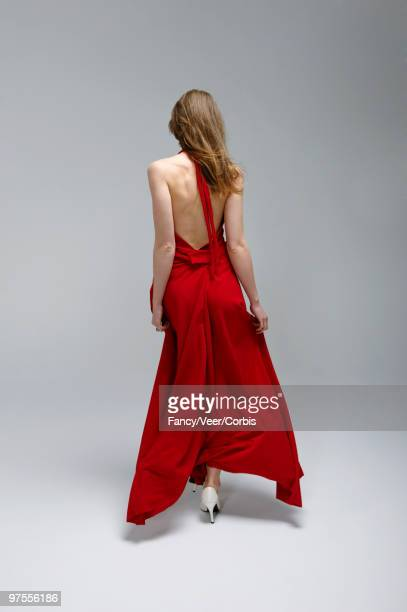 Fashion model in red dress and white shoes