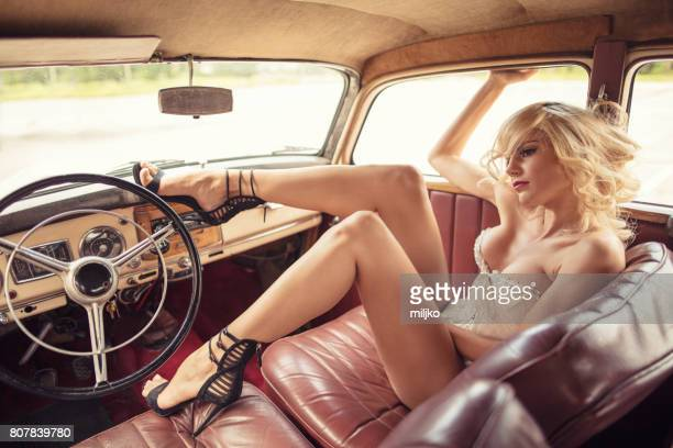 fashion model in vintage car - beautiful legs in high heels stock photos and pictures