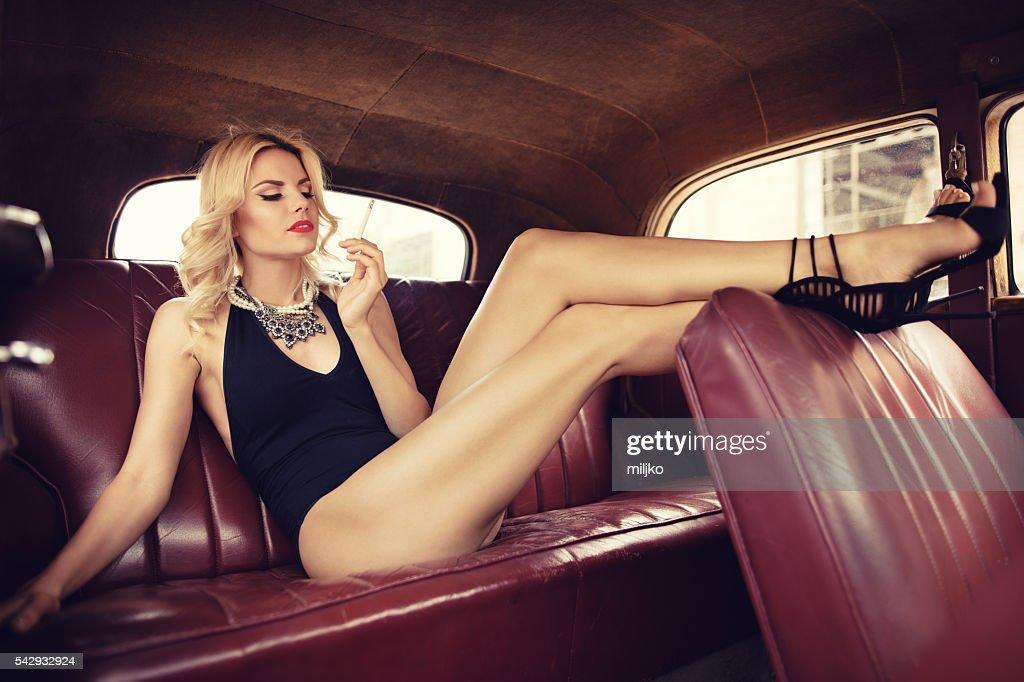 Fashion model in vintage car. Retro style : Stock Photo