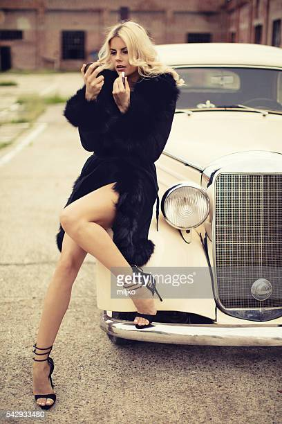 fashion model in vintage car. retro style - high heels photos stock photos and pictures