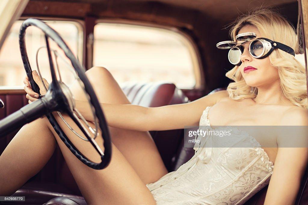 Fashion model in vintage car. Retro style