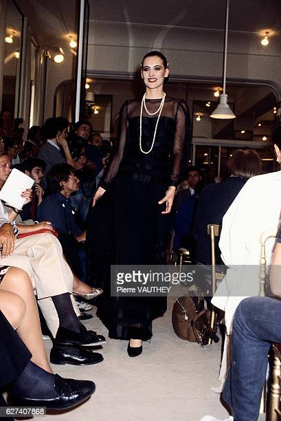 Fashion model Ines de la Fressange models women's haute couture fashions from French fashion house Chanel in a 19821983 fallwinter fashion show Her...
