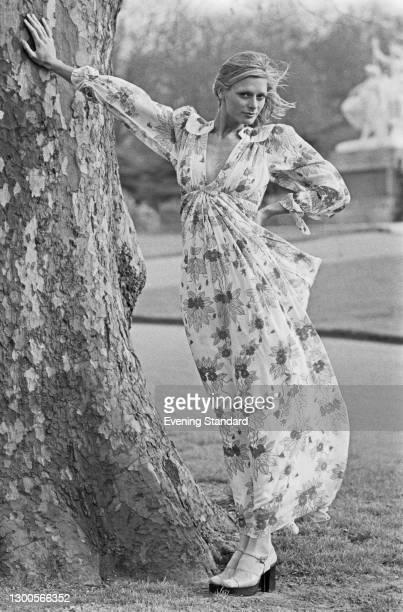 Fashion model Inger Kent wearing a floral summer dress, UK, 6th April 1973.