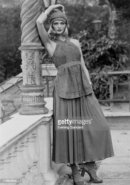 Fashion model Inger Kent wearing a suede halterneck tunic and a long skirt, UK, 27th October 1972.