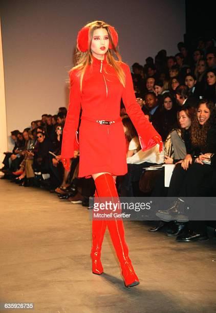 Fashion model Ivanka Trump models a red dress for Marc Bouwer's fall fashion show.