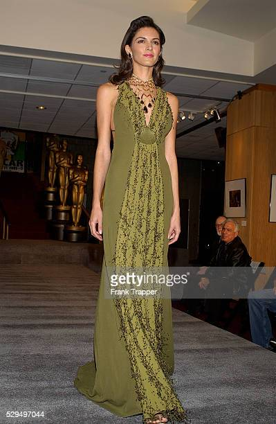 Fashion model Jennifer wears a Citrine by Sully Bonnelly olive gown with Chopard golden diamond choker with cognac and champagne diamonds at the 77th...